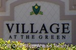 sign for Village at the Green